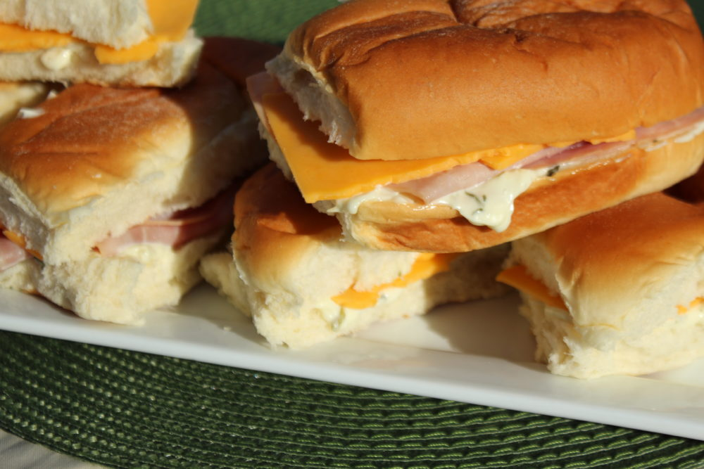 Hawaiian sub sandwiches made with spinach dip, ham, sliced cheese or vegetarian without ham a simple party sub. Party-subs-ham-or-vegetarian-made-with-spinach-dip #appetizers #easyappetizer #appetizerrecipe #subs #subsandwiches #fingerfood #partyfood