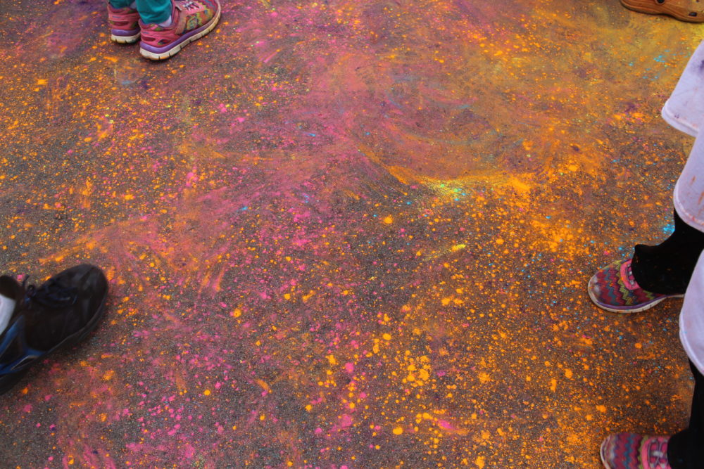6 Tips to Make exercise more fun for the family. Colorful ground at Color Run and tennis shoes. #exercise #familyfun #familytime #healthylifestyle #exercisingwithfamily #exercisingwithkids