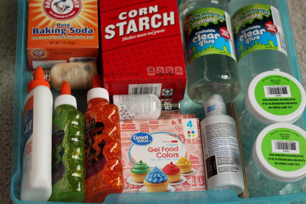 DIY Slime Kit Gift for Crafty Kids bin filled with supplies. #diygifts #craftsforkids #kidscrafts #craftsupplies #diyproject #diychristmasgift #diyholidaygift #giftsforkids #giftideasforkids #creativekids #holidaygiftideasforkids