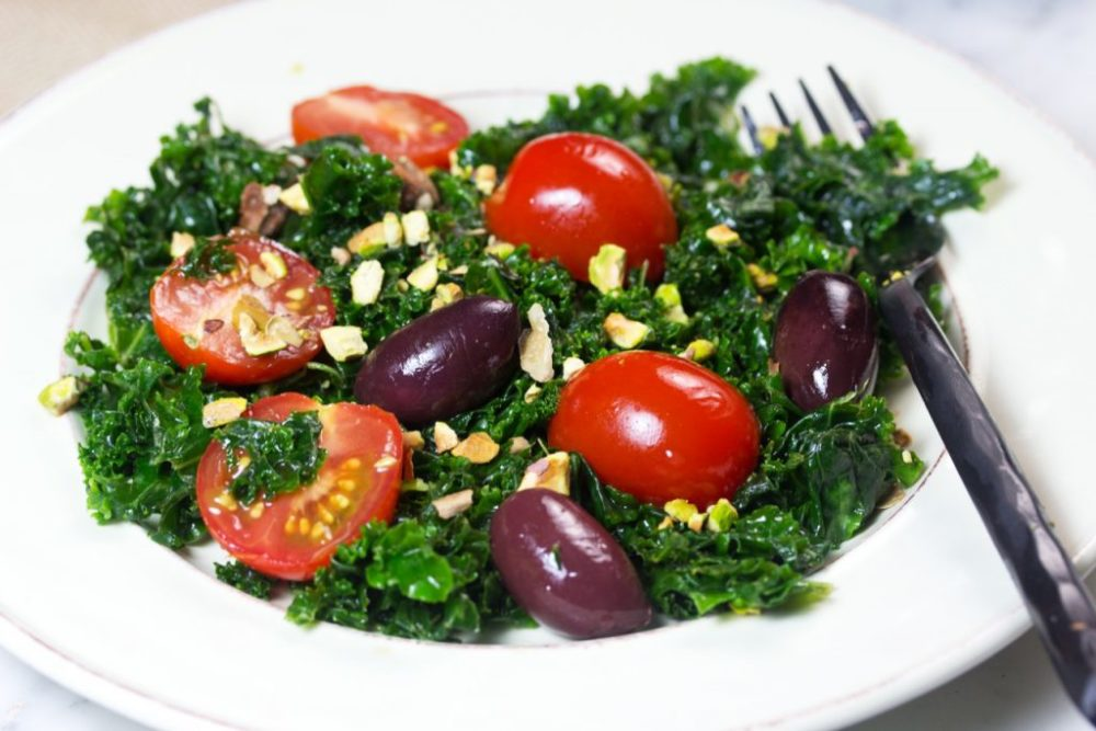 Kale salad with pistachios, tomatoes, olives vegetable side dish vegetarian recipe. #salad #sidedish #vegetarian #vegetarianrecipe #meatless #dinnerideas #lunchideas