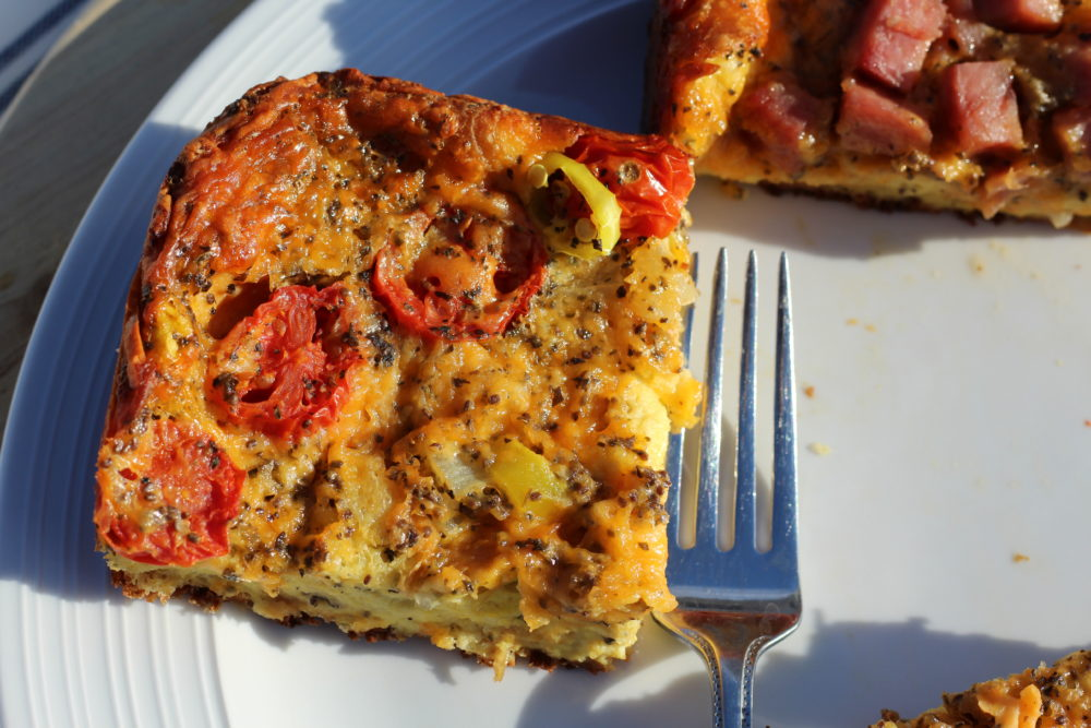 Tomato Basil Hybrid Vegetarian & Ham Croissant Crust Quiche Vegetarian piece. #quiches #breakfast #breakfastrecipes #brunch #brunchideas #eggs #hybrid #vegetarianrecipes #lunch