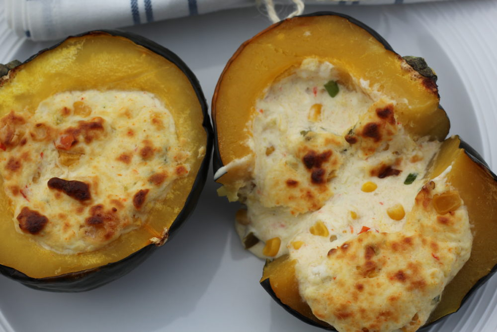 Twice Baked Acorn Squash Stuffed with Cheese and Corn vegetable side dish or vegetarian main course. Squash recipe. #vegetarian #vegetarianrecipes #squash #twicebakedsquash #recipe #easyrecipe #easyrecipes #sidedish #vegetable #fallfood #cheese #corn #delicious #meatless #meatlessmonday twice baked acorn squash stuffed cheese corn