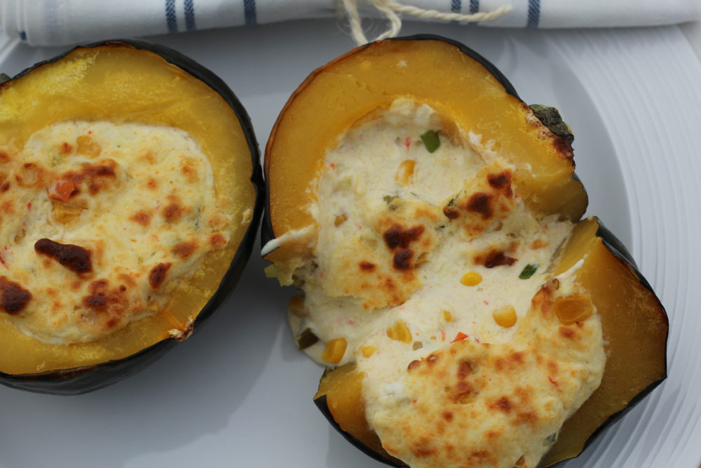 Twice Baked Acorn Squash Stuffed with Cheese and Corn vegetable side dish or vegetarian main course. Squash recipe. #vegetarian #vegetarianrecipes #squash #twicebakedsquash #recipe #easyrecipe #easyrecipes #sidedish #vegetable #fallfood #cheese #corn #delicious #meatless #meatlessmonday