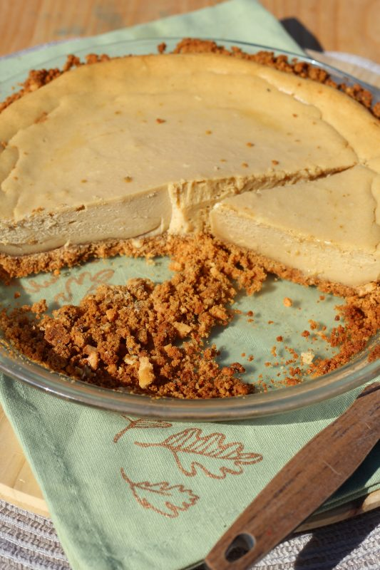 Cookie Butter Cheesecake with Crumbly Cashew Graham Cracker Crust in pie pan