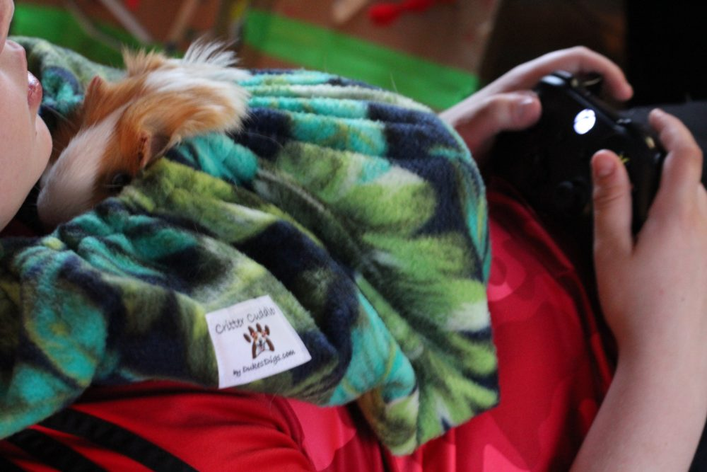Guinea Pig Fleece Snuggle Sack For Unparalleled Bonding while gaming. A perfect guinea pig accessory for kids who have guinea pigs as pets. This guinea pig fleece is a soft, washable bonding bag that makes guinea pigs feel safe and secure.