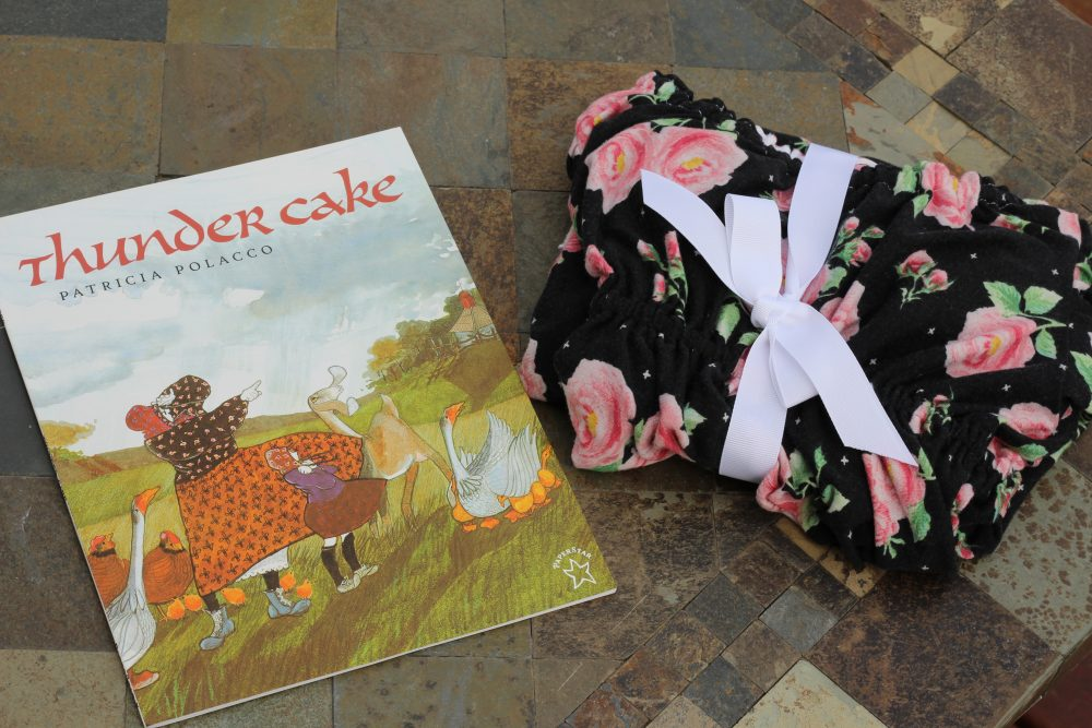 Handmade girls nightgown and childrens book Thunder cake. Distraction and ideas to help kids cope with fears of thunderstorms. Childhood fears and anxiety in kids concerning thunderstorms.