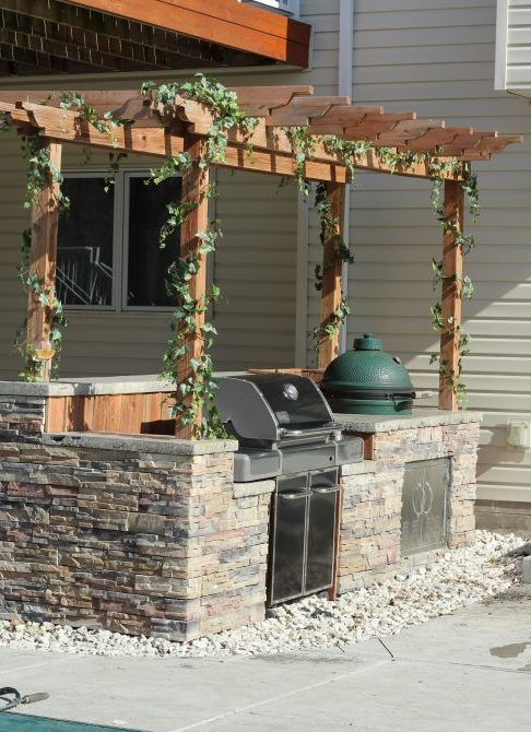 Full outdoor kitchen with ivy vines. Home decor and patio decorating at home.