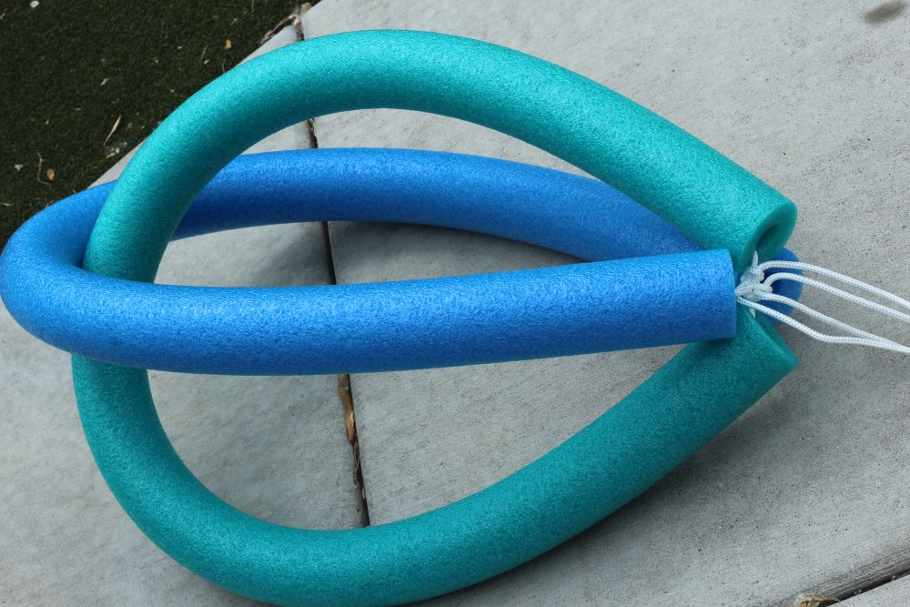 DIY Pool Floaty Toy Made with Pool Noodles and rope. Easy to make, fun to play with and float in.