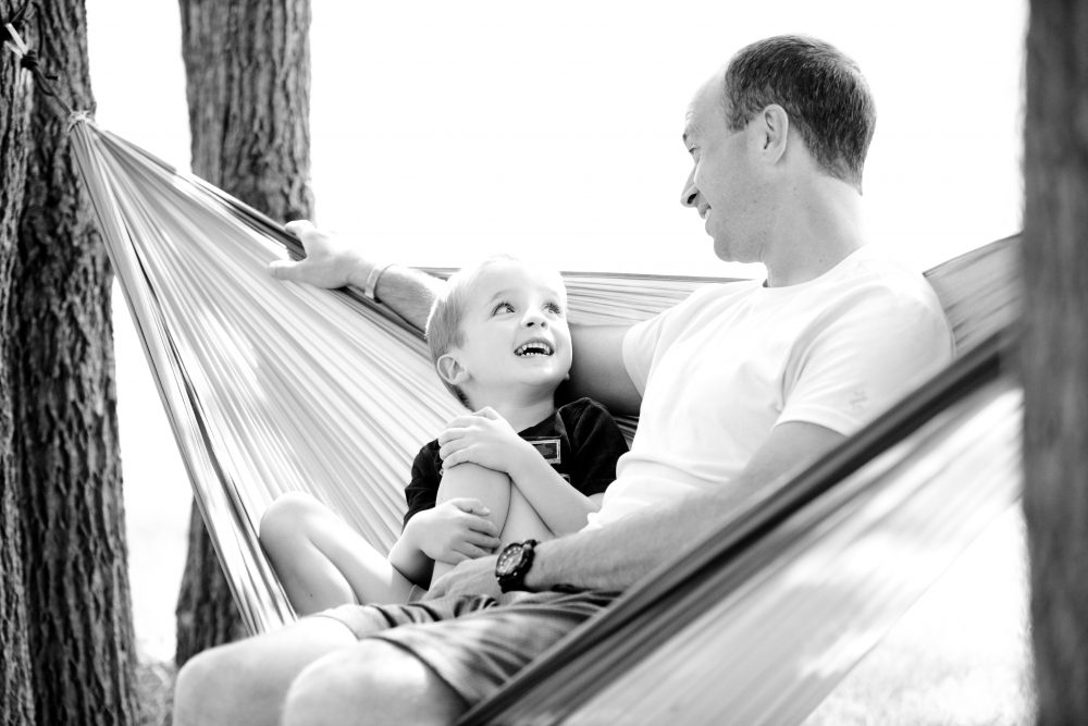 5 Fun Harmless Memorable Rule Breakers Kids Love. Ways of Making memories with kids. Dad and child in a hammock relaxing
