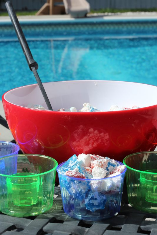 Easy No Bake Dessert Salad for the 4th of July with colorful single serve bowls at a pool party. An easy simple dessert recipe for a side dish at a family dinner or a dessert at home or a party. #partyfood #fourthofjulyrecipe