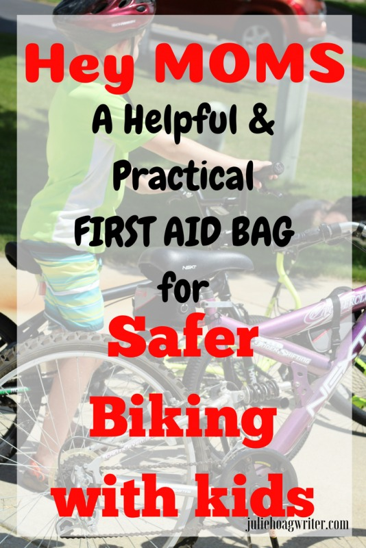 Hey Moms a helpful and practical first aid bag for safer biking with kids is the perfect way to do a bicycling outing this summer. This first aid kit attaches to the bike easily and in a non-intrusive way. Be prepared for injuries while out biking with your kids. #momhacks #bicycle #firstaidkit #motherhood #moms #bikeride #firstaidbag #mother #bikingwithkids #momlife #mama #mamalife #lifehacks #bike #emergency #children #kids #activities #summer #juliehoagwriter