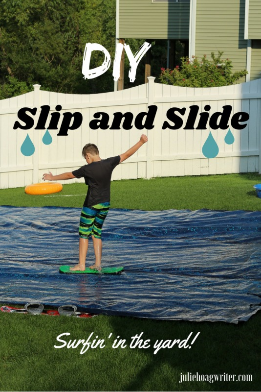 Pool Owners Upcycle the Old Solar Pool Cover as a DIY Slip and Slide for family fun in your own backyard this summer. Surfin' in the yard, make it happen at your own home! Super fun kids activity and great for parties too! #pool #family #kids #diy #slipandslide #partyideas #summer #summerfun #summervibes #swimmingpool #poolownertips #upcycle #creative #ideas #backyard #diyslipandslide #boredombuster #juliehoagwriter
