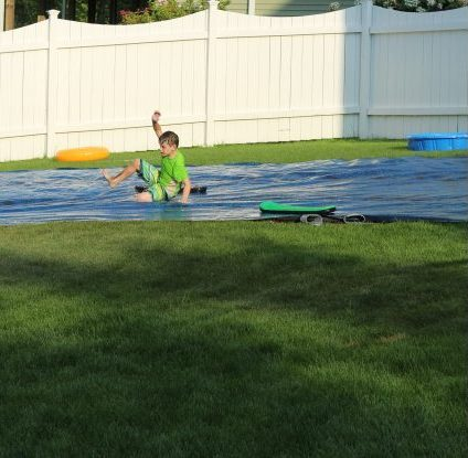 Pool Owners Upcylce the Old Solar Pool Cover as a DIY Slip and Slide. Summer fun idea for kids, tweens, teens. Great boredom buster in summer. #summer #summervibes #family #slipandslide #diyslipandslide #slipnslide