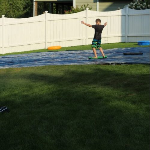 Pool Owners Upcycle the Old Solar Pool Cover as a DIY Slip and Slide