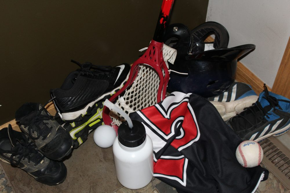 Mom humor Pinterest fail for home organization youth sports equipment shoes water bottle in a pile.