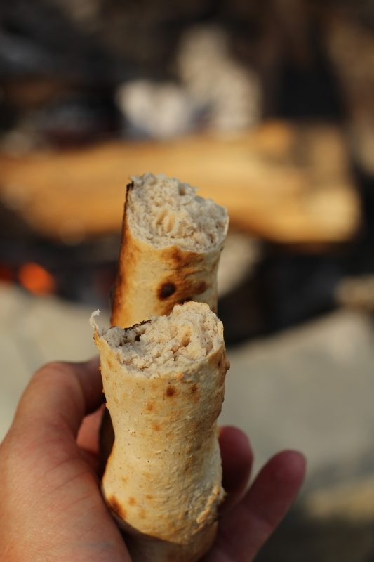 Campfire Cooking Cinnamon Breadsticks Recipe for Camping and Backyard Bonfires cook the bread slow to thoroughly cook.