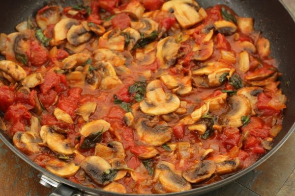 Orange Marinated Mushrooms in Tomato Basil Sauce to put over penne pasta for a vegetarian entree main dish