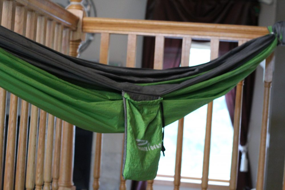 Portable Kids' Hammock for home, backyard, and camping. Hammock child and guinea pig snuggling and relaxing together. A great spot for relaxation, reading, bonding with a pet, taking a nap, or listening to music. A self care moment for kids. #selfcare #kids #hammocks #backyard #relaxation