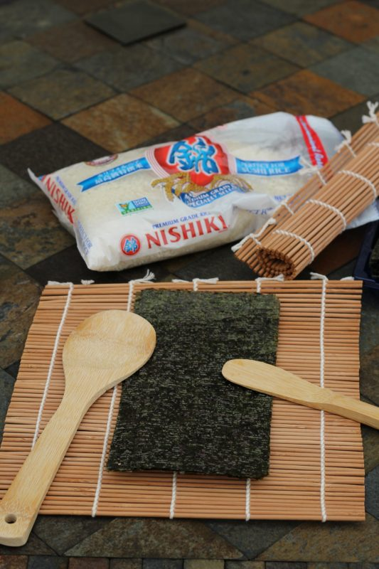 DIY sushi making kit with sushi rice. Make a Christmas present cooking kit for kids interested in the culinary arts. This DIY sushi roll kit is easy to use. Cooking with kids.