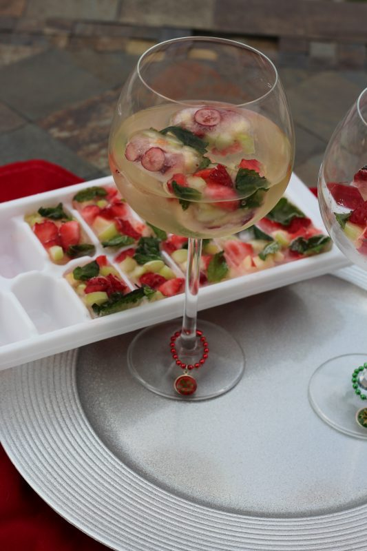 Festive Christmas Wine with Fruit Ice Cubes red and green holiday cocktail. Holiday cocktails for a fun Crhistmas drink recipe. Non-alcoholic ice cubes for mocktails. 21+