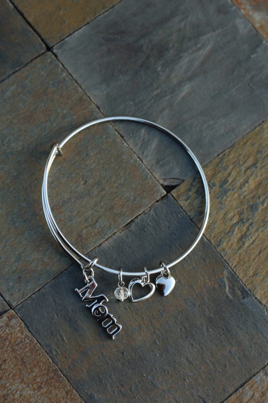 Mom Jewelry Christmas Presents for moms. Christmas presents for her. Holiday gifts for her. Holiday gifts for moms. Mom wearing silver mom jewelry bracelet with charms. Holiday gifts for her.