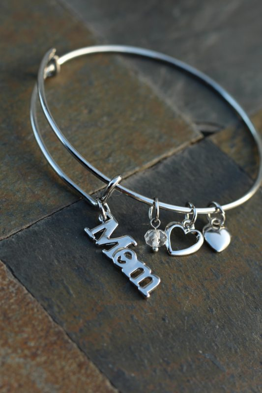 Mom Jewelry Christmas Presents for moms. Christmas presents for her. Holiday gifts for her. Holiday gifts for moms. Mom wearing silver mom jewelry bracelet with charms