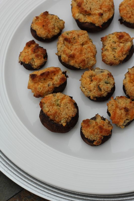 Vegetarian Stuffed Mushrooms made with three cheeses, jalapenos, and pine nuts. A meatless appetizer recipe for the holidays, Christmas, parties, football parties. An easy meatfree appetizer recipe.