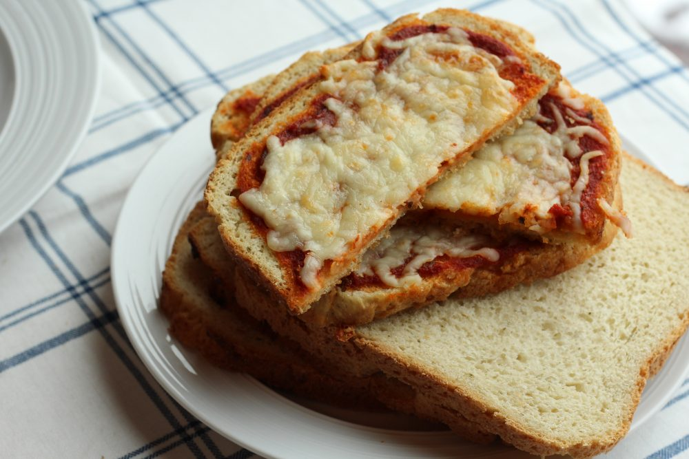 Delicious Breadmaker Bread Toast Pizza recipe for lunch or dinner. A family pizza night option using pizza bread slices for the crusts of the personal pizzas. Make it meatless cheese or with meat, perfect for a split table meal. Hybrid recipe.