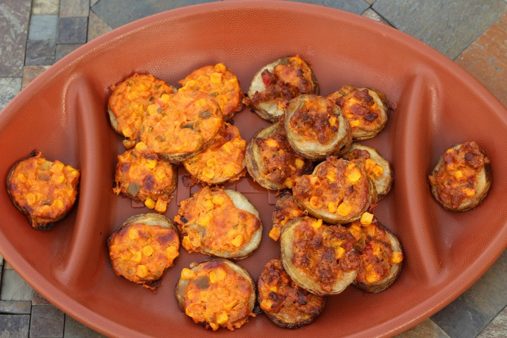 Football platter of Potato Slices Topped with Spicy Cheese and Sweet Corn Appetizer Recipe. Football party appetizers, make some with sausage and make some meatless to feed all your party guest. Party finger food for all.