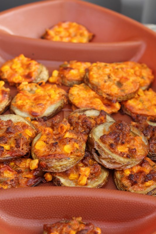 Super Bowl appetizer topped potato slices. Party food, finger food, Super Bowl appetizers for a crowd. A delicious appetizer to make for vegetarians and meat-eaters. Love the diversity, please every one of your houseguests.