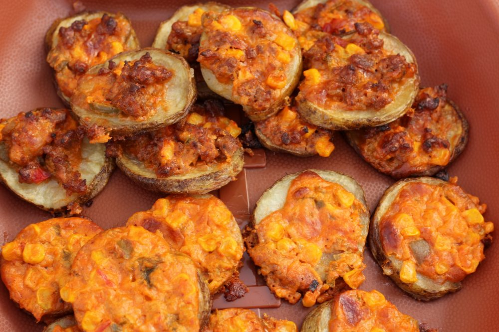 Potato Slices Topped with Spicy Cheese and Sweet Corn Appetizer Recipe hybrid for a split table a Super Bowl appetizer for parties. Meat and potatoes,and vegetarian loaded potato bites.