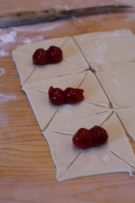 Cherry Tarts A Yummy Pastry for Dessert fold into a star shape