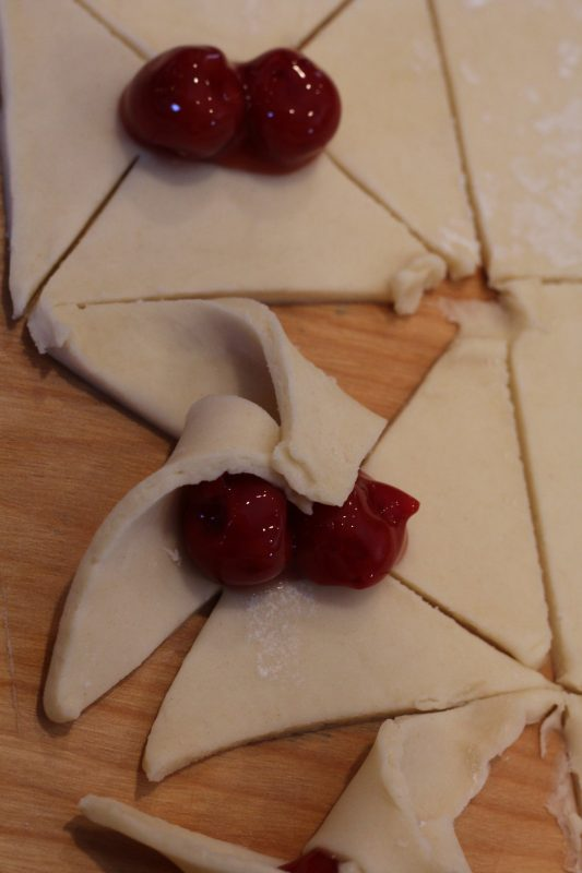 Cherry Tarts A Yummy Pastry for Dessert for Valentine's Day, Christmas, Easter. A tasty homemade star-shaped cookie with cherry pie filliing. A delicious pastry cookie for the dessert table. Party food, finger food, sweet treats.