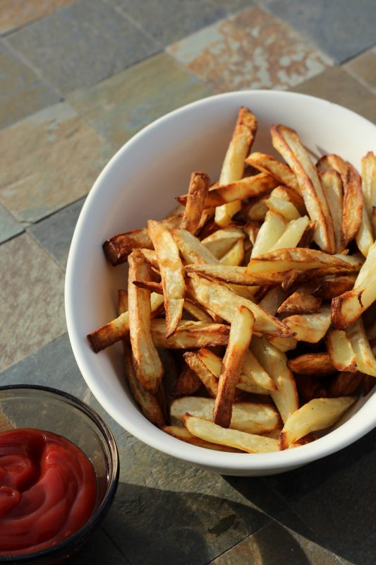 Easy air fryer french fries made at home using coconut oil. A delicious low fat french fry recipe using only two teaspoons of coconut oil. A tasty side dish, snack, or appetizer.