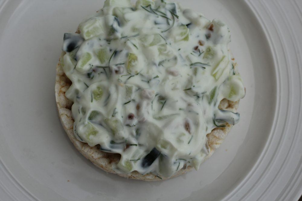 Ten Healthy Recipes for Rice Cake Toppings. Creamy rice cake topping with cucmbers, dill, onion, sunflower seeds light meal