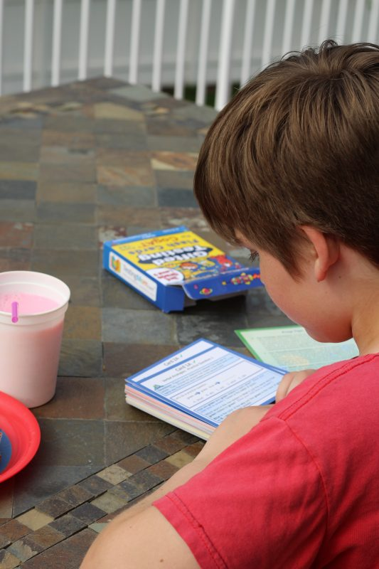 Standardized test practice for Elementary School aged kids flash cards and test prep looking at cards