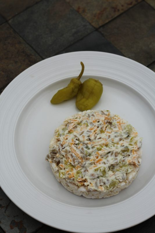 10 healthy rice cake toppings, rice cake topping with cream cheese, sunflower seeds, cheddar cheese, jalapenos and peperoni peppers snack or light meal