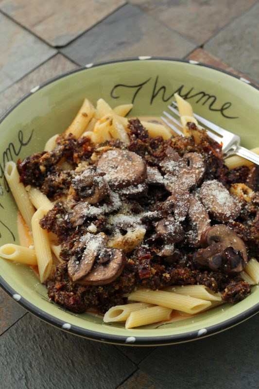 Homemade pesto sauce with sun dried tomatoes and pasta a dinner recipe