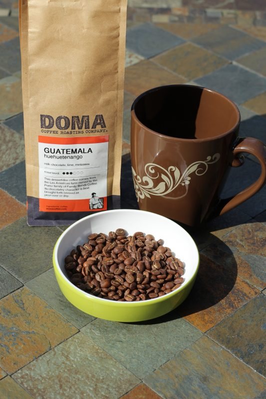Guatemalan coffee beans and coffee mug and coffee bean bag
