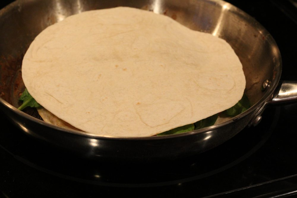 Top with a quesadilla. Butter and flip once golden on the bottom.