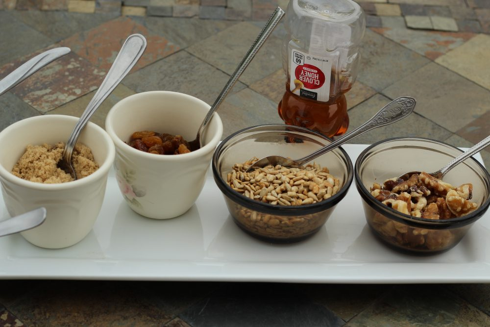 raisins brown sugar sunflower seeds walnuts and honey toppings for oatmeal