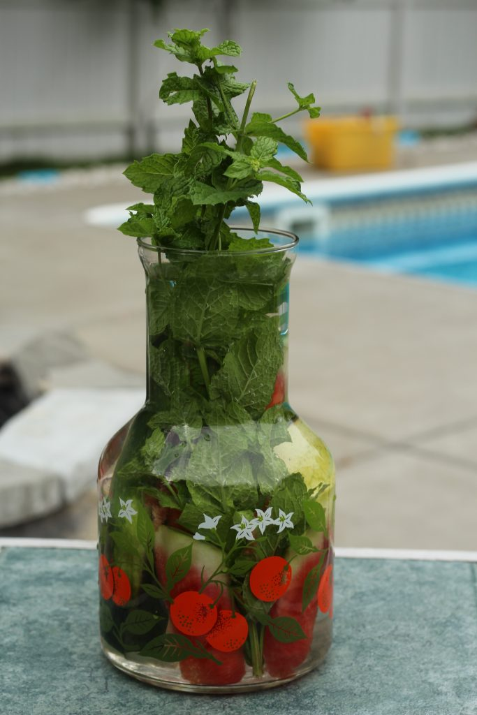 watermelon infused water with mint leaves and cucumber spears
