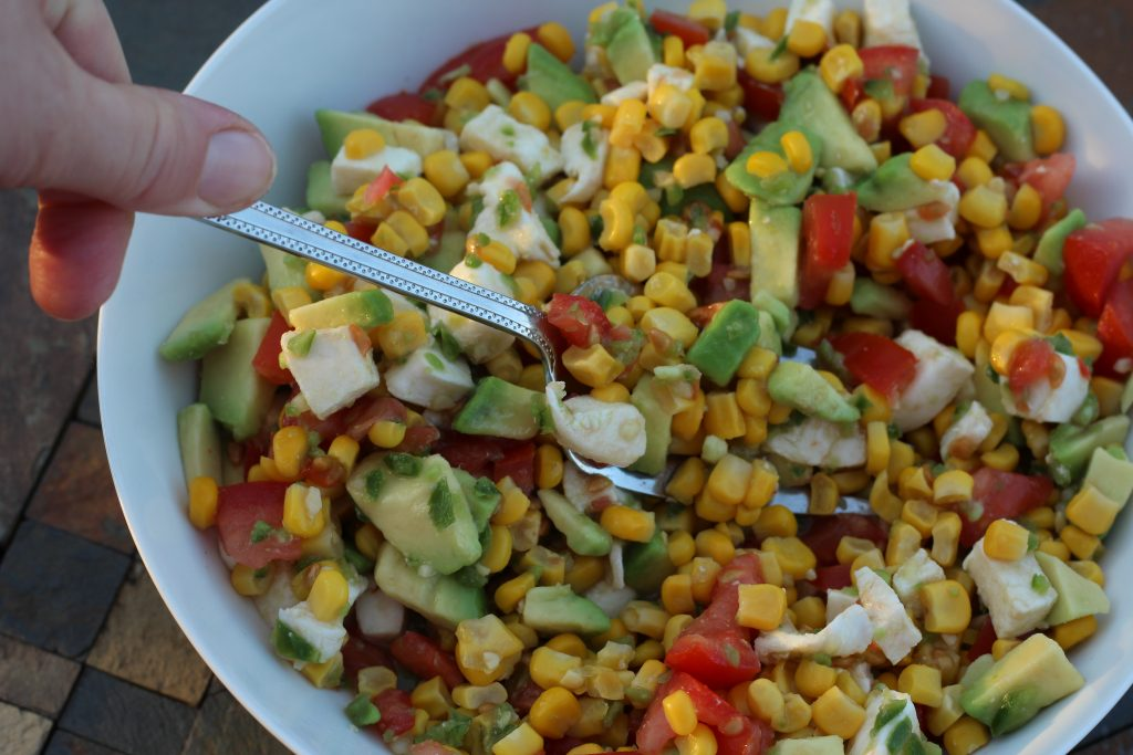 corn tomato avocado salad side dish full of fiber and with added in protein from cheese