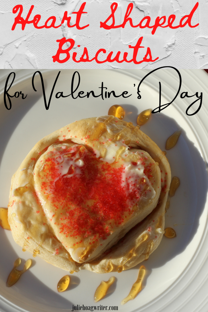 Heart shaped biscuits for Valentine's Day topped with honey and butter