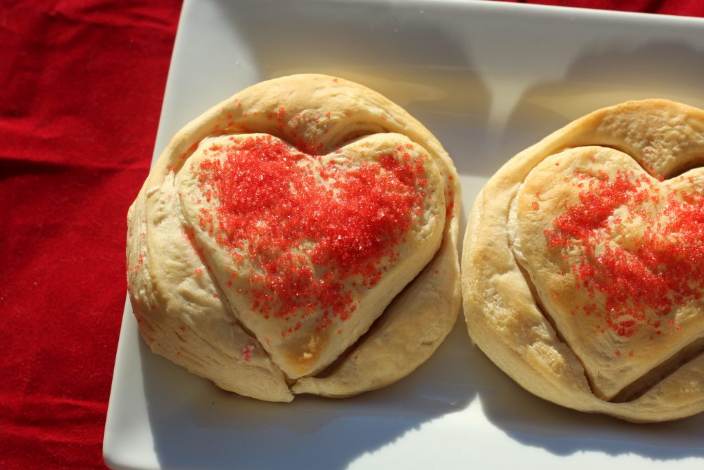 Heart shaped biscuits for Valentine's Day cooked and on a plate