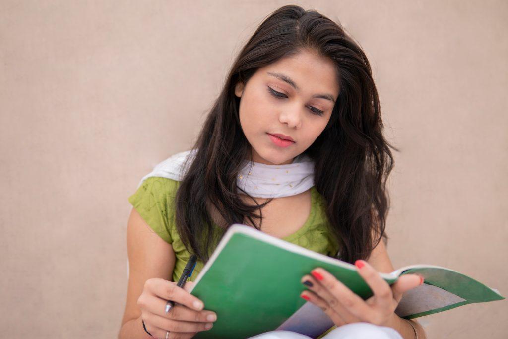 young adult dystopian novels teen boy reading a book
